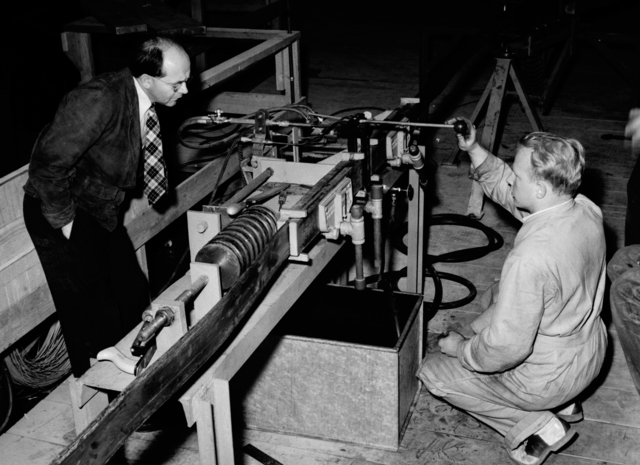 Bill Brower (left) and William C. Twitchell with brazing machine making joint for 184-inch cyclotron coils, taken March 8, 1942. Principal Investigator/Project: Analog Conversion Project [Photographer: Donald Cooksey]