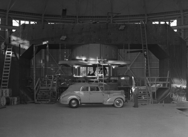 "Ernest Orlando Lawrence's 1941 ""160"" Packard with 184-inch cyclotron, taken March 8, 1942. Principal Investigator/Project: Analog Conversion Project [Photographer: Donald Cooksey]"
