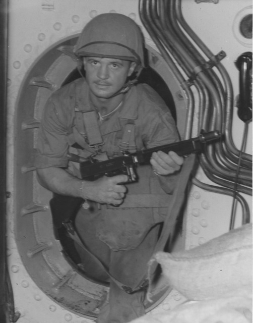 Photograph of Corporal Vernon F. Paulstick, a Marine Commando aboard the USS Nautilus Going Top Side for Raid on Makin Island