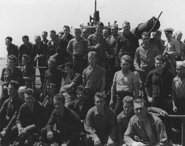 Photograph of Marine Commandos aboard USS Nautilus Entering Pearl Harbor after Raid on Makin Island