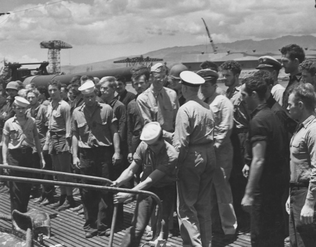 Photographs of Admiral Chester W. Nimitz Boarding USS Argonaut as She Docks in Pearl Harbor after Makin Island Raid