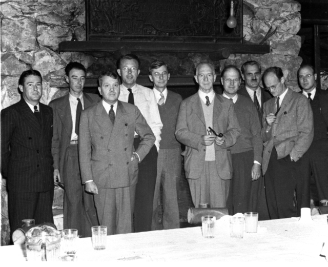 Office of Scientific Research and Development (OSRD) party at Bohemian Grove on September 14, 1942. From left: Unknown, Robert Oppenheimer, Harold C. Urey, Ernest Orland Lawrence, James B. Conant, Lyman J. Briggs, E.V. Murphree, A.H. Compton, Robert Thornton, and unknown individual. Morgue 1958-8 (P-71) [Photographer: Donald Cooksey]