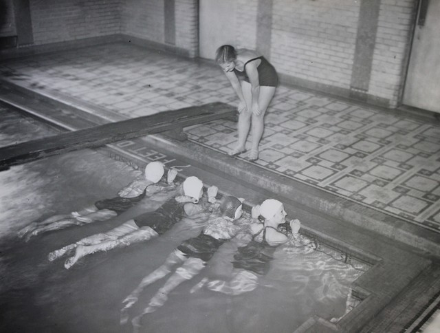 A National Youth Administration Worker Teaches a Swim Class