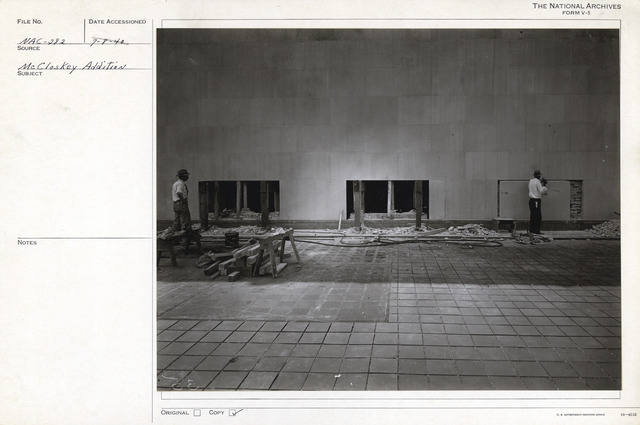 Photograph of Stonemasons Working on the Roof of the National Archives Building