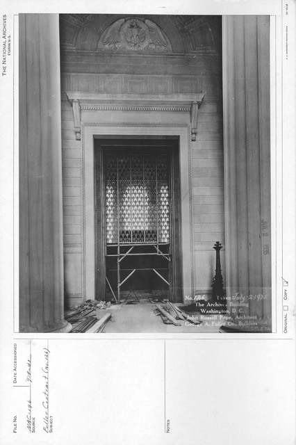 Photograph of the Installation of the Window Screen in the Constitution Avenue Entrance of the National Archives Building