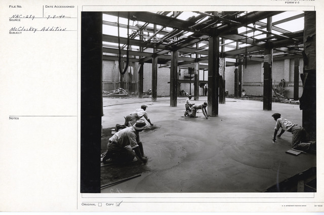 Photograph of Workers Finishing the Floor of a Stack Area in the National Archives Building