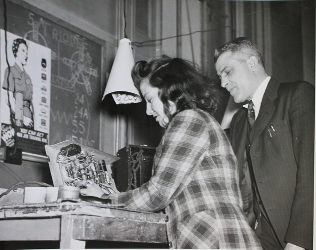 Young Woman in Radio Repair Shop