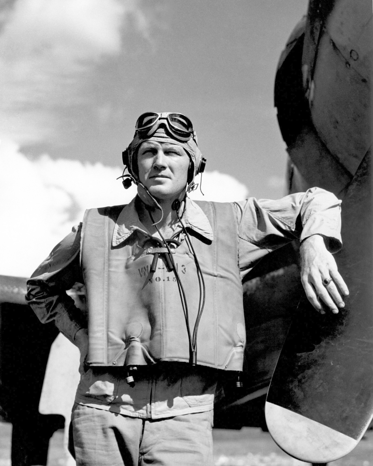 """World War II (WWII) era photograph of US Marine Corps (USMC) First Lieutenant (1LT) Sheldon O. Hall, standing next to a US Navy (USN) F4U""""CORSAIR""""aircraft at Henderson Field, Guadalcanal, 1943. 1LT Hall is an Ace Pilot credited with 6 kills. His hometown is Ottawa, Ohio.  (Exact date shot unknown)"""