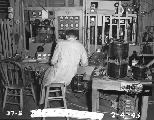 "37-inch cyclotron, technician at control panel. Photo taken 2/04/1943. 37""-5. Principal Investigator/Project: Analog Conversion Project"