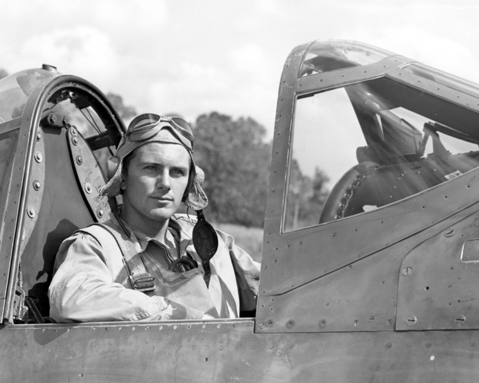 "World War II (WWII) era photograph of US Marine Corps (USMC) First Lieutenant (1LT) Paul A. Mullen, taken in the cockpit of a USMC F4U""CORSAIR""aircraft at Guadalcanal, June 6, 1943. 1LT Mullen is an ace pilot and is credited with 6 kills. His hometown is 45 Ordale Boulevard, Pittsburgh, Pennsylvania"