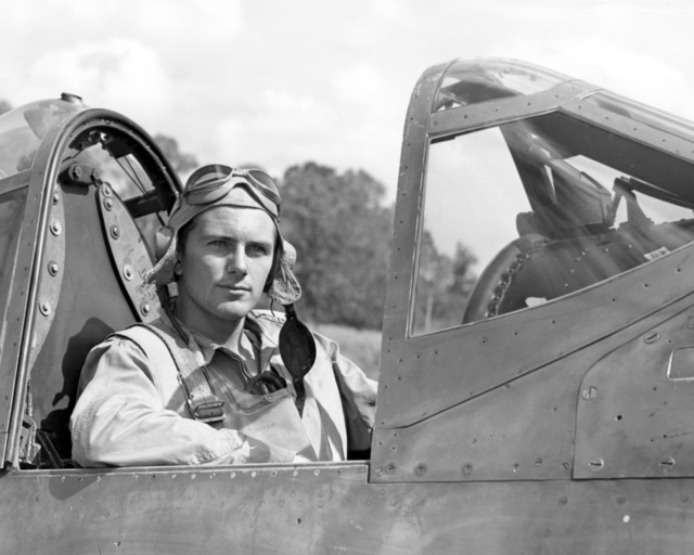 """World War II (WWII) era photograph of US Marine Corps (USMC) First Lieutenant (1LT) Paul A. Mullen, taken in the cockpit of a USMC F4U""""CORSAIR""""aircraft at Guadalcanal, June 6, 1943. 1LT Mullen is an ace pilot and is credited with 6 kills. His hometown is 45 Ordale Boulevard, Pittsburgh, Pennsylvania"""
