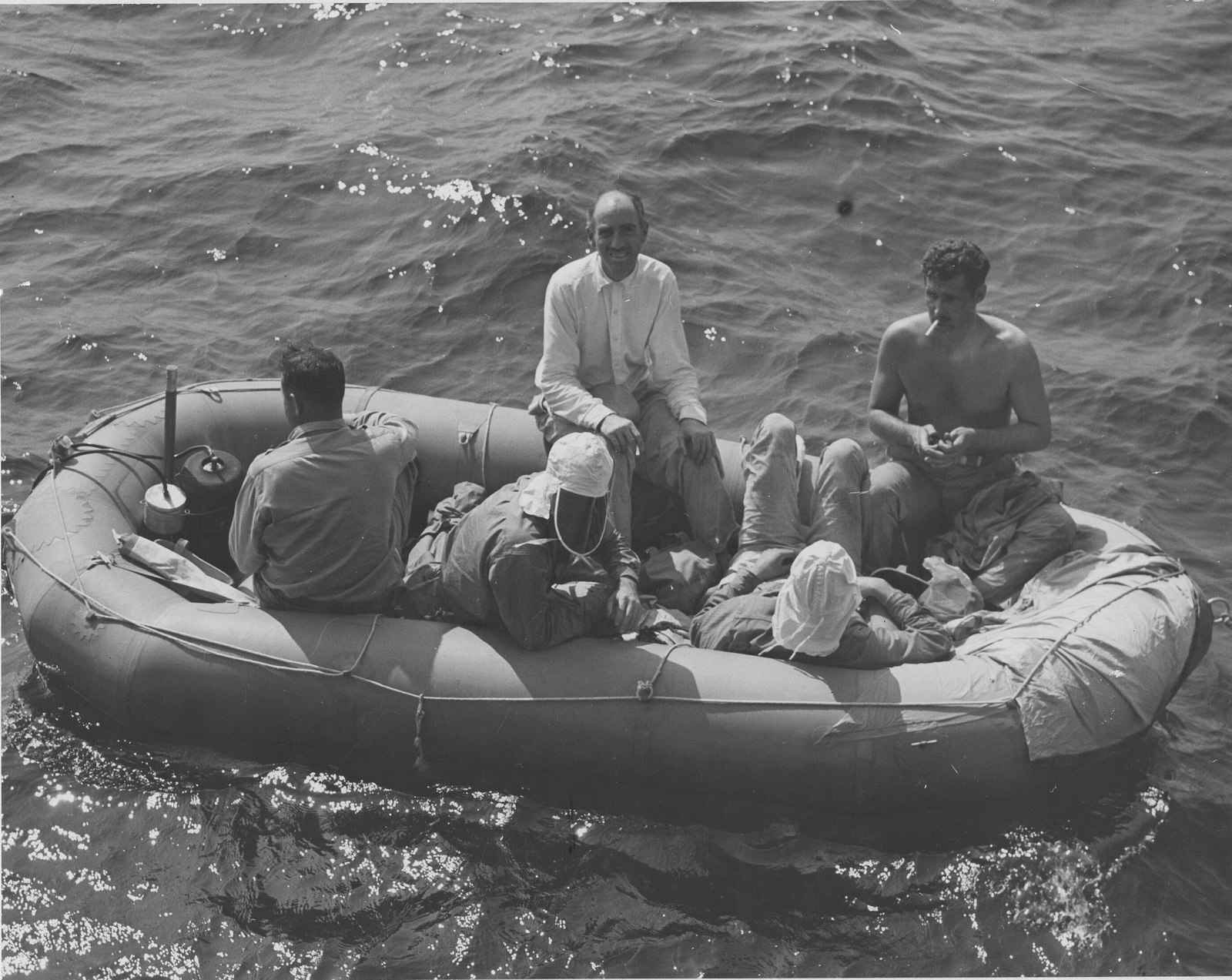 Photograph of Men Testing Rubber Life-Rafts and Accessories