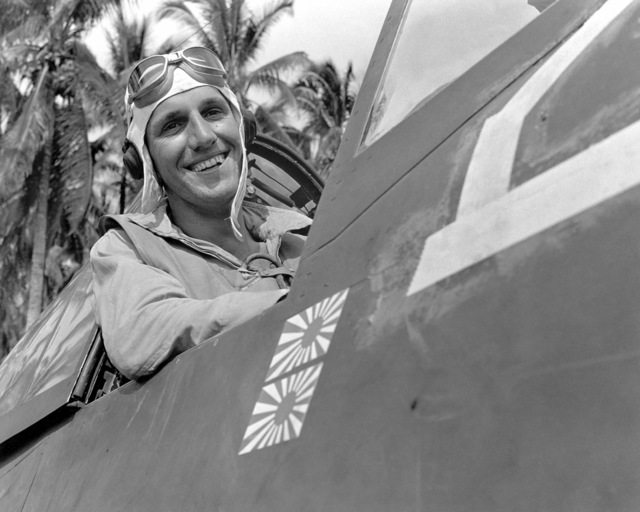 "World War II (WWII) era photograph of US Marine Corps (USMC) Technical Sergeant (TSGT) Jack Pittman, Jr, taken at Russell Island, July 4, 1943 as he sits in the cockpit of a USMC F4U""CORSAIR""aircraft. TSGT Pittman is an Ace Pilot credited with 7 kills. His hometown is Amarillo, Texas"