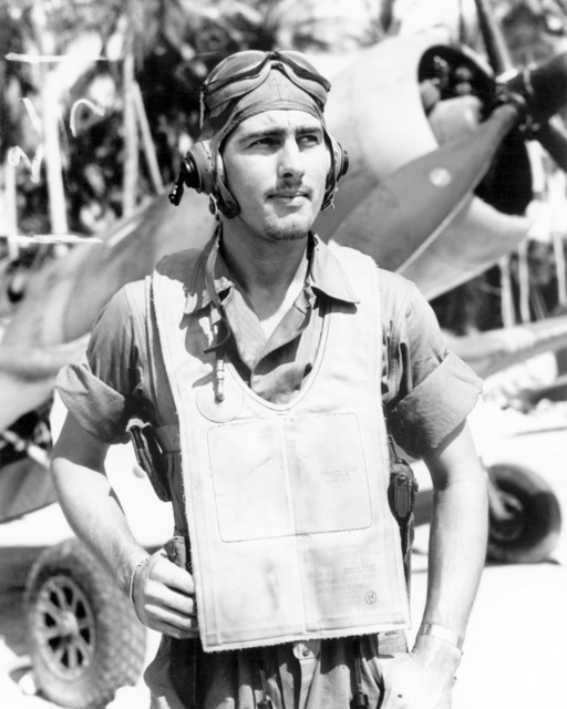 "World War II (WWII) era photograph of US Marine Corps (USMC) Second Lieutenant (2LT) Alvin J. Jensen, standing in front of a US Navy (USN) F4U""CORSAIR""aircraft at Vella LaVella, Soloman Islands, November 14, 1943. 2LT Jensen is an Ace Pilot credited with 7 kills"