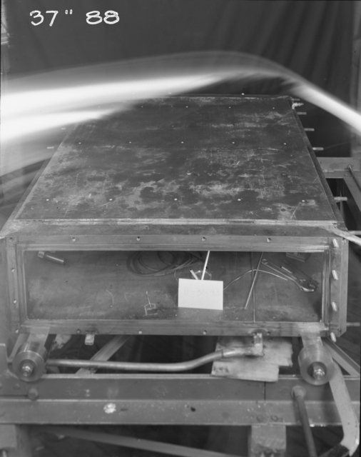 """New 37-inch cyclotron tank plate on. Note on original: Taken just as the ghost of Edison flew over. Photo taken 11/30/1943. 37""""-88. Principal Investigator/Project: Analog Conversion Project"""