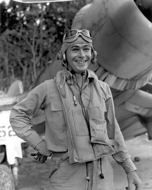 """World War II (WWII) era photograph of US Marine Corps (USMC) First Lieutenant (1LT) John F. Bolt, Marine Fighter Squadron 214 (VMF-214)""""Black Sheep""""taken at Vella La Vella, December 5, 1943 as he stands in front of a USMC F4U""""CORSAIR""""aircraft. 1LT Bolt is an Ace Pilot credited with 6 kills. His hometown is Sanford, Florida"""