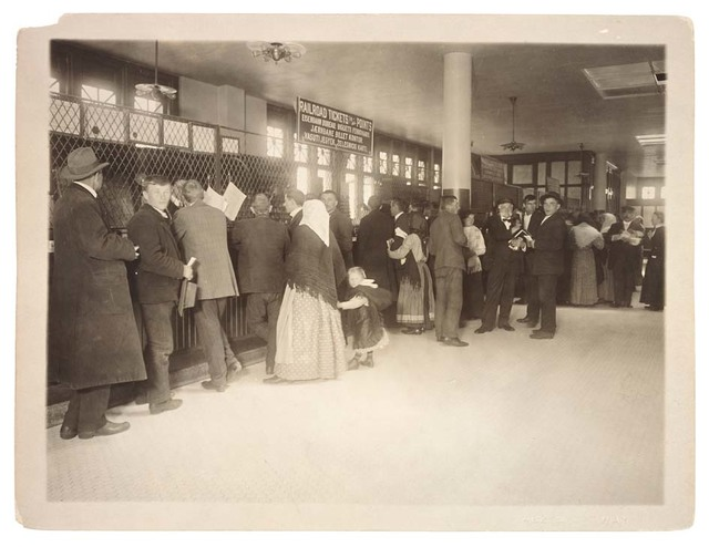 Photograph of Immigrants Buying Railroad Tickets on Ellis Island