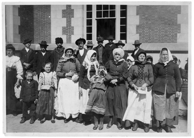 Photograph of Immigrants Outside a Building on Ellis Island