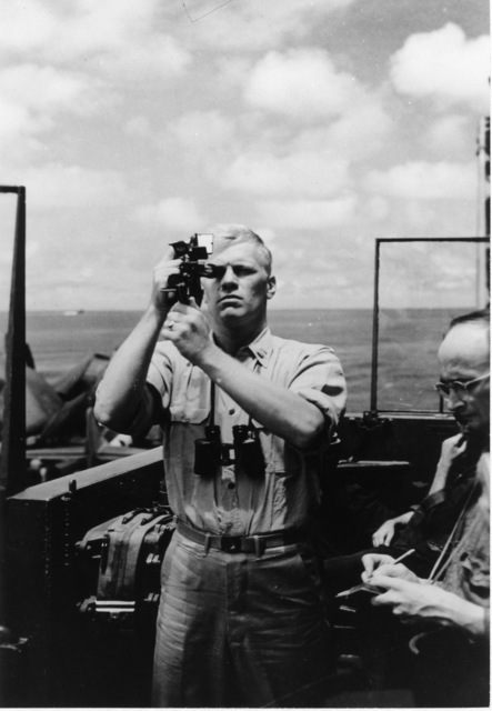 Photograph of Navigation Officer Gerald Ford Taking a Sextant Reading aboard the USS Monterey