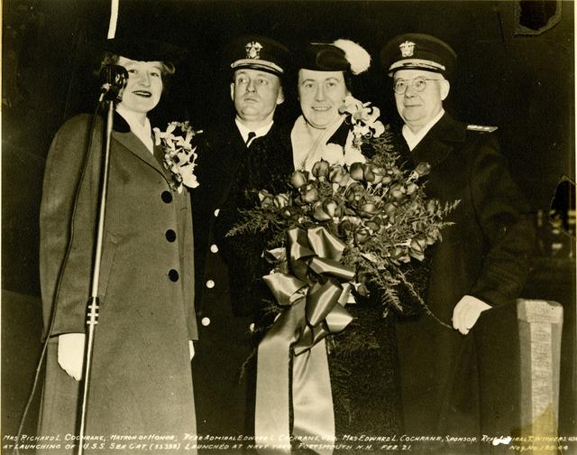 Mrs. Richard L. Cochrane, Rear Admiral Edward L. Cochrane, Mrs. Edward L. Cochrane, and Rear Admiral T. Withers at the Launch of the USS Sea Cat