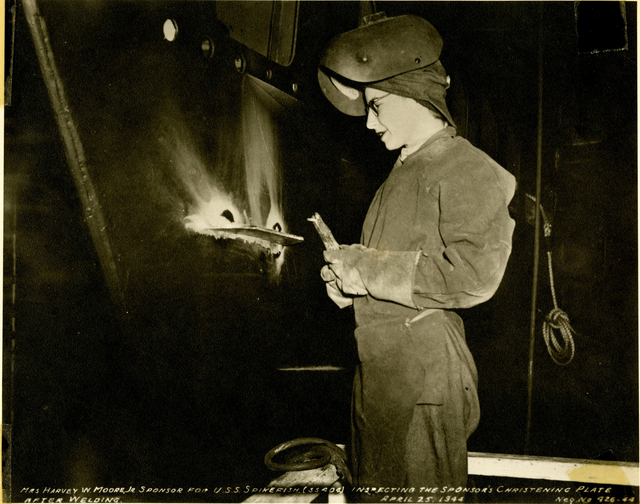 Mrs. Harvey W. Moore, Jr., Inspects the Sponsor's Christening Plate Weld on the USS Spikefish