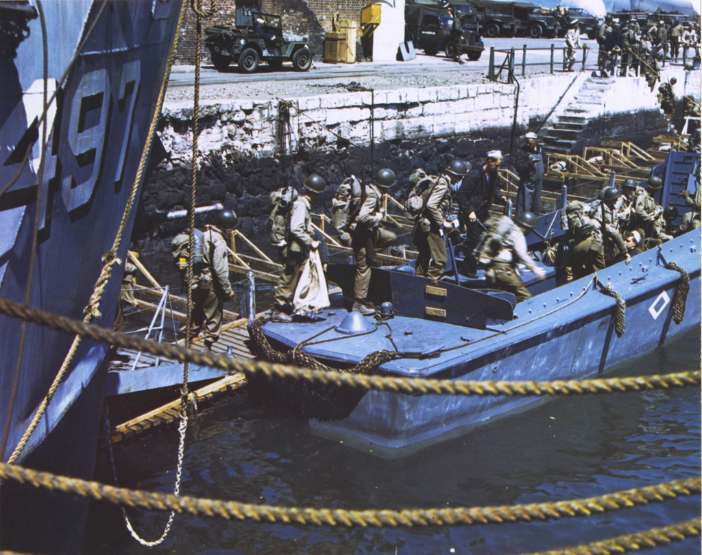 Photograph of American Troops Descending into Barges in a British Port Town as they Prepare for the Normandy Invasion
