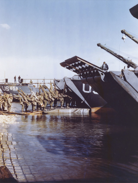 Photograph of Medics and Litter Bearers Going Up the Ramp of an LCT as the Prepare for the Normandy Invasion