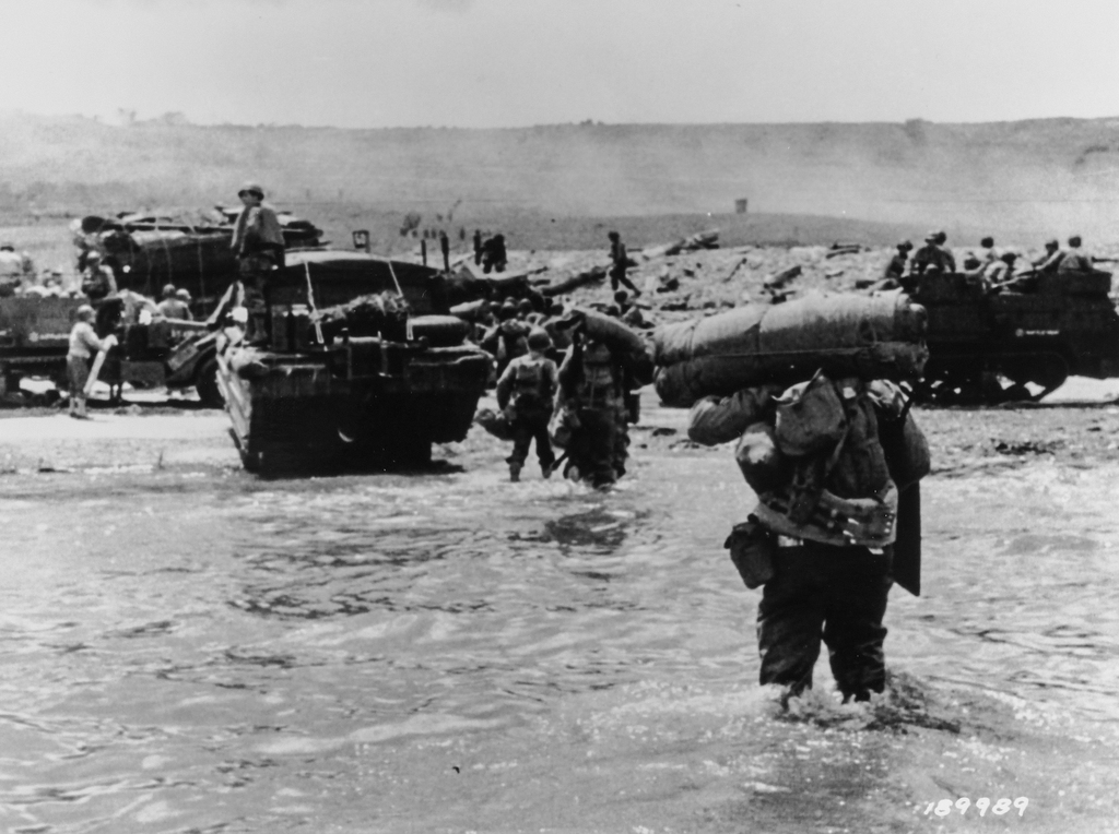 Photograph of American Assault Troops with Full Equipment Moving onto Omaha Beach