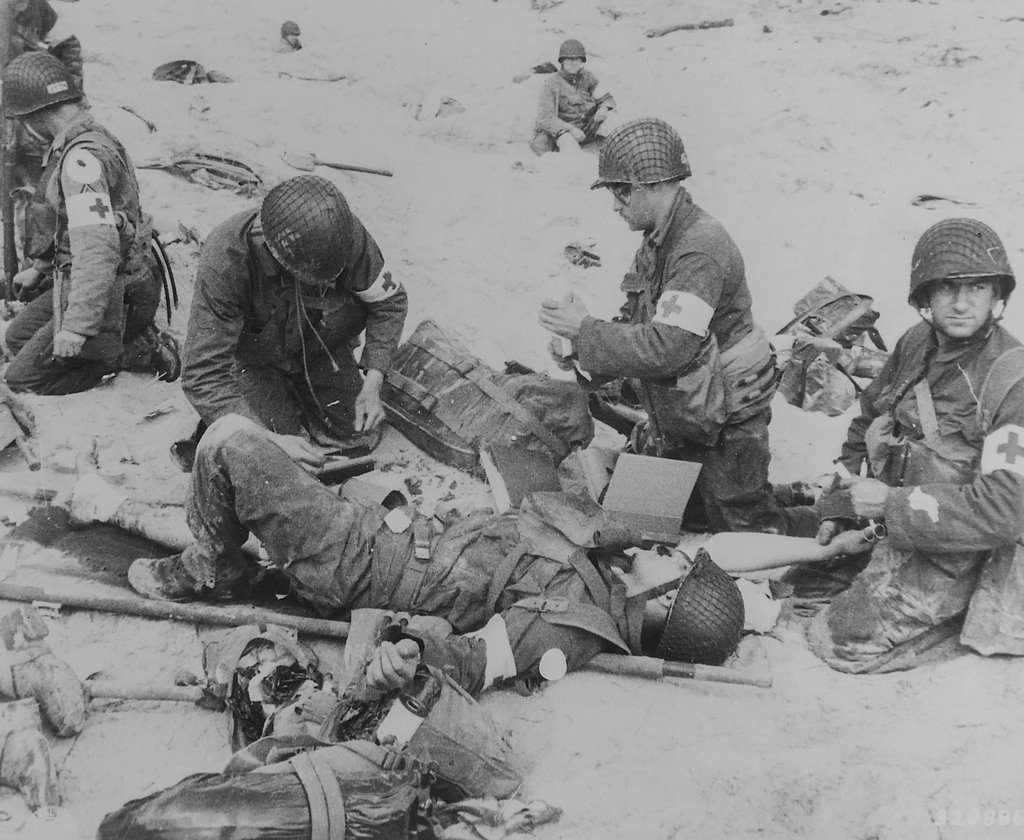 Photograph of American Medics Rendering First Aid to Troops in the Initial Landing on Utah Beach