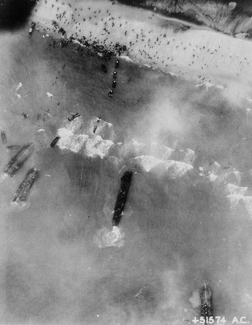 Photograph of Men and Assault Vehicles Storming the Beaches of Normandy