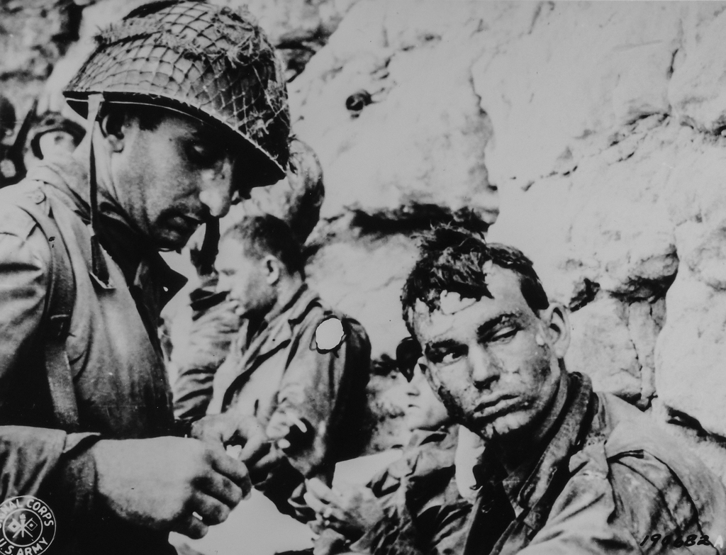 Photograph of an American Medical Officer Bandaging the Hand of an American Soldier