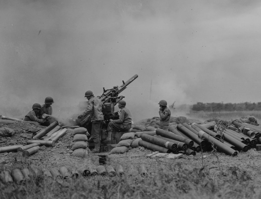 Photograph of American Gun Battery of an Anti-aircraft Unit Going into Action on Omaha Beachhead, near Vierville Sur-mer, France