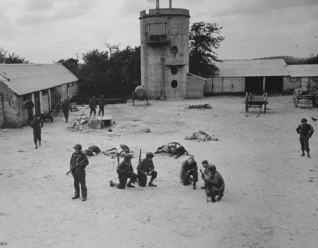 Photograph of American Troops in the Yard of a Farmhouse They Have Just Cleared of German Snipers