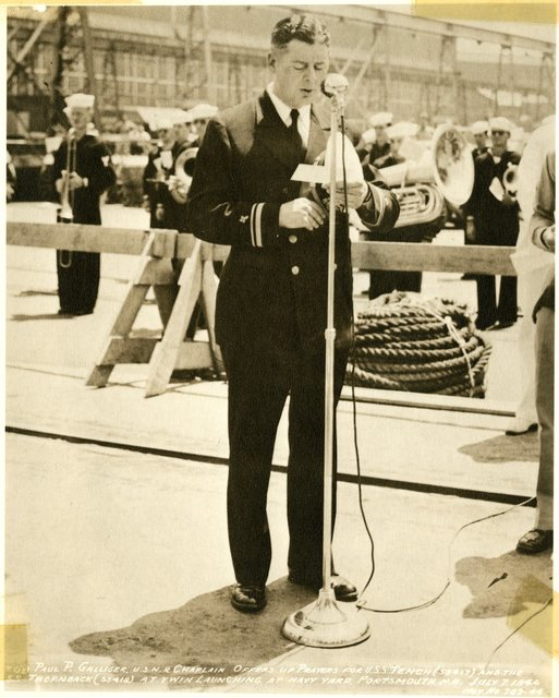 Chaplain Paul P. Galliger Offers Prayers for the USS Tench