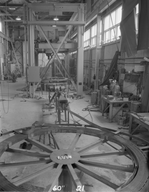 "Re-coiling 60-inch coil for magnet, 60-inch cyclotron. Photo taken 7/22/1944. 60""-21 Principal Investigator/Project: Crocker Lab/60-inch"