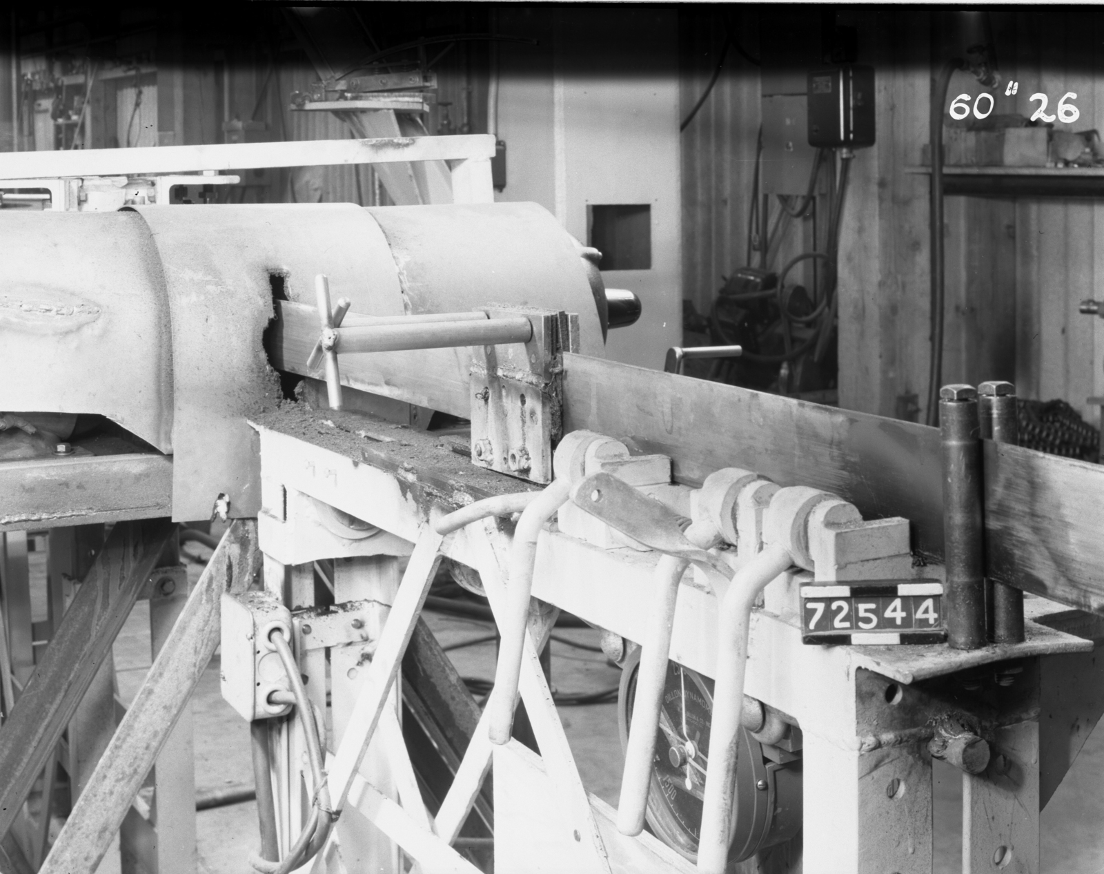 """60-inch coil winding. Copper ribbon passing through tension brake and buffer motors after annealing, 60-inch cyclotron. Photo taken 7/25/1944. 60""""-26; ZN-707 Principal Investigator/Project: Crocker Lab/60-inch"""
