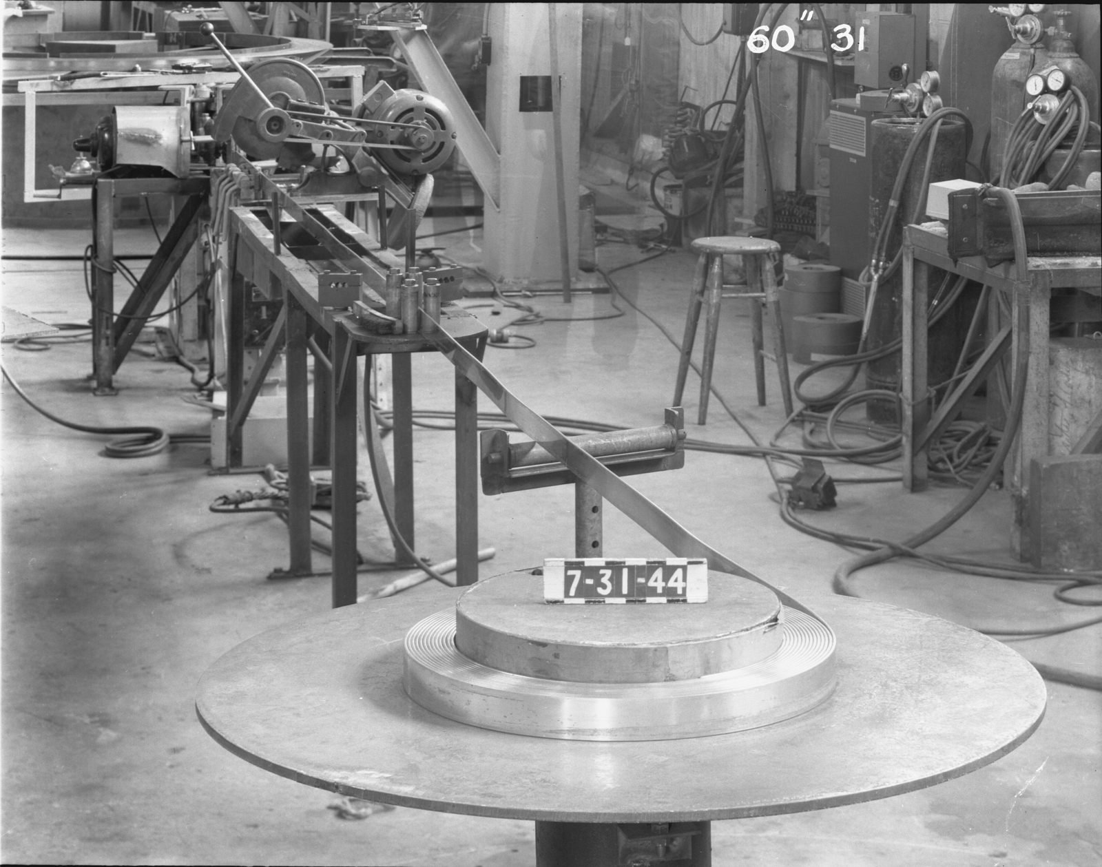 """Winding the lower 60-inch magnet (new copper stock), 60-inch cyclotron. Photo taken 7/31/1944. 60""""-31 Principal Investigator/Project: Crocker Lab/60-inch"""