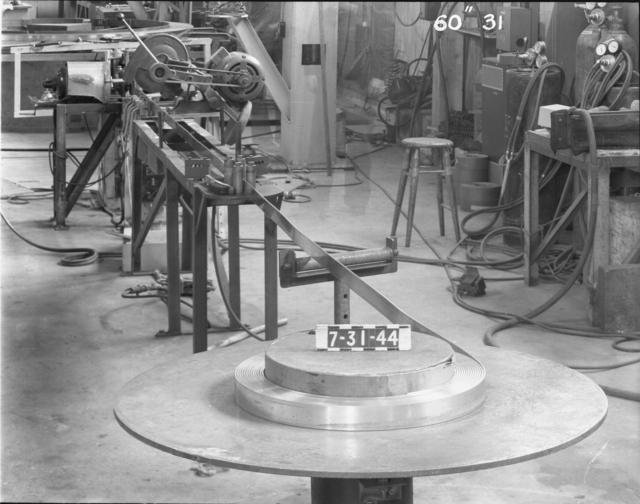 "Winding the lower 60-inch magnet (new copper stock), 60-inch cyclotron. Photo taken 7/31/1944. 60""-31 Principal Investigator/Project: Crocker Lab/60-inch"