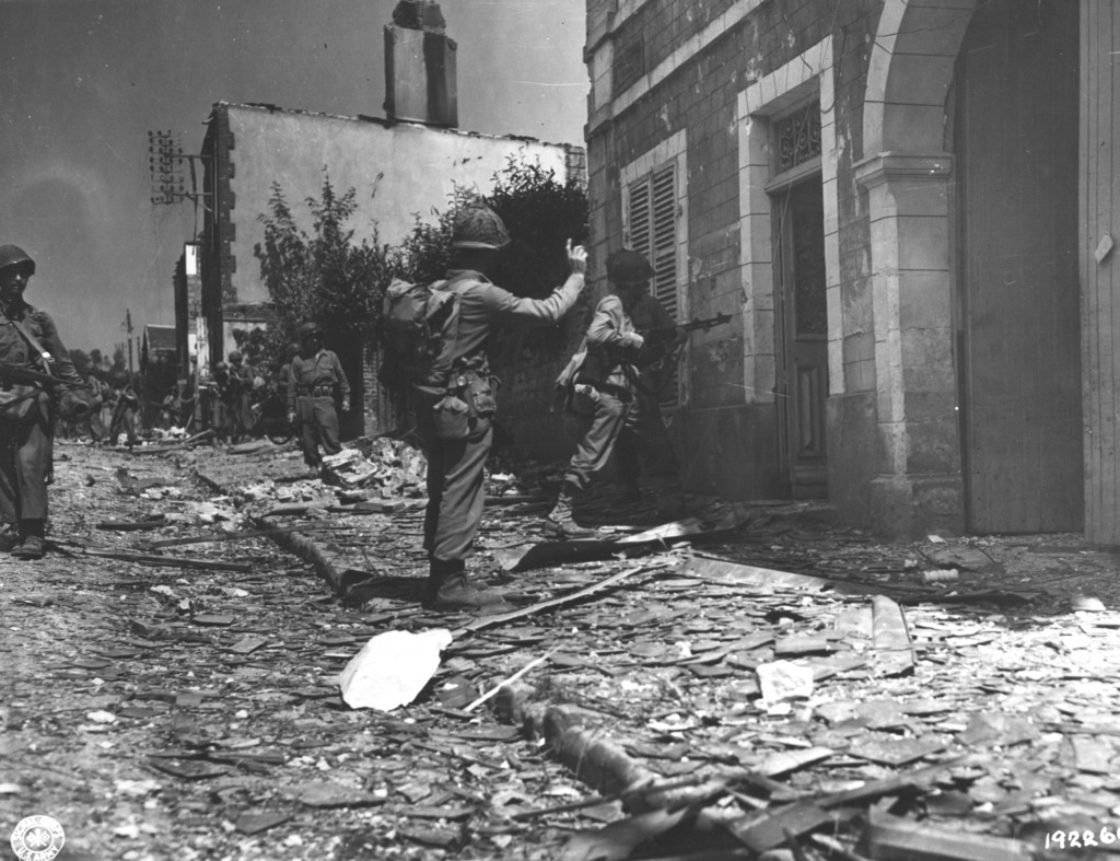 Photograph of a BAR Gunner Entering a Building Suspected of Housing Snipers in Percy, France
