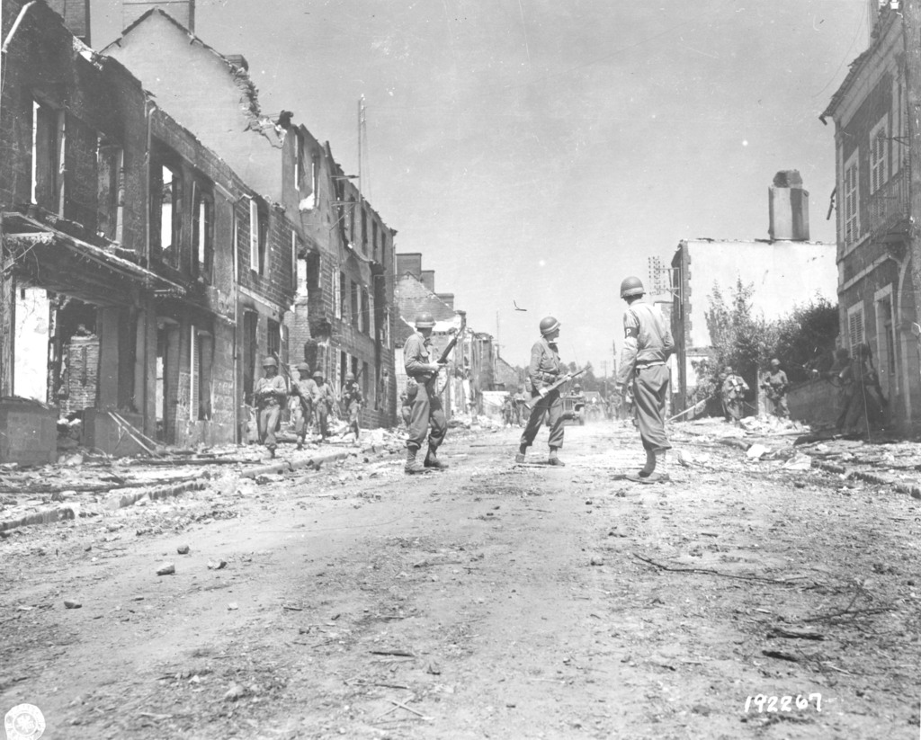 Photograph of Infantrymen Moving into the Town of Percy, France