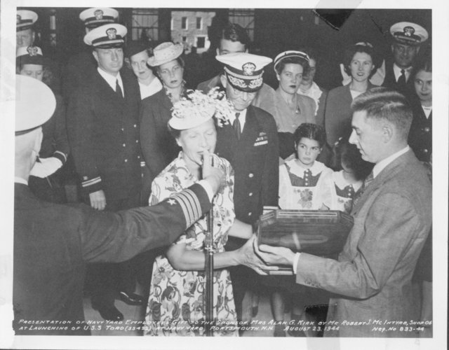 Presentation of Navy Yard Employees Gift to the Sponsor Mrs. Alan G. Kirk by Mr. Robert J. McIntyre, Shop 06 at the Launching of the USS Toro (SS 422) at Navy Yard, Portsmouth, New Hampshire