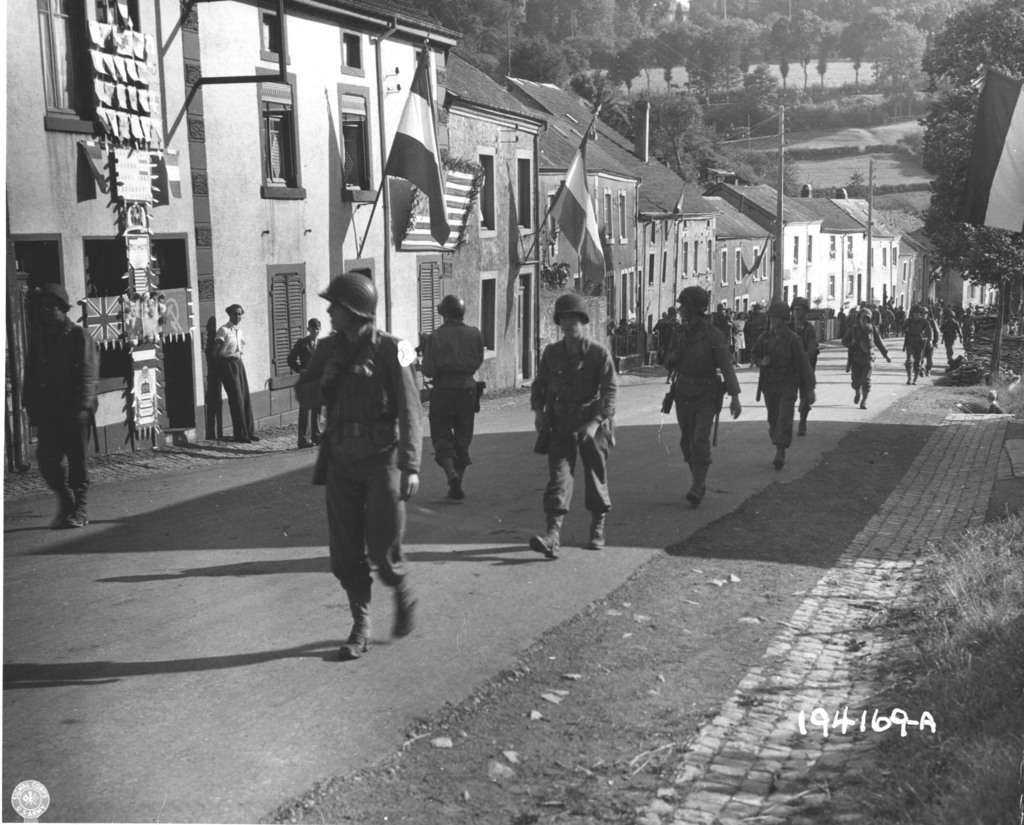 Photograph of Infantrymen Passing through Witte, Luxemburg