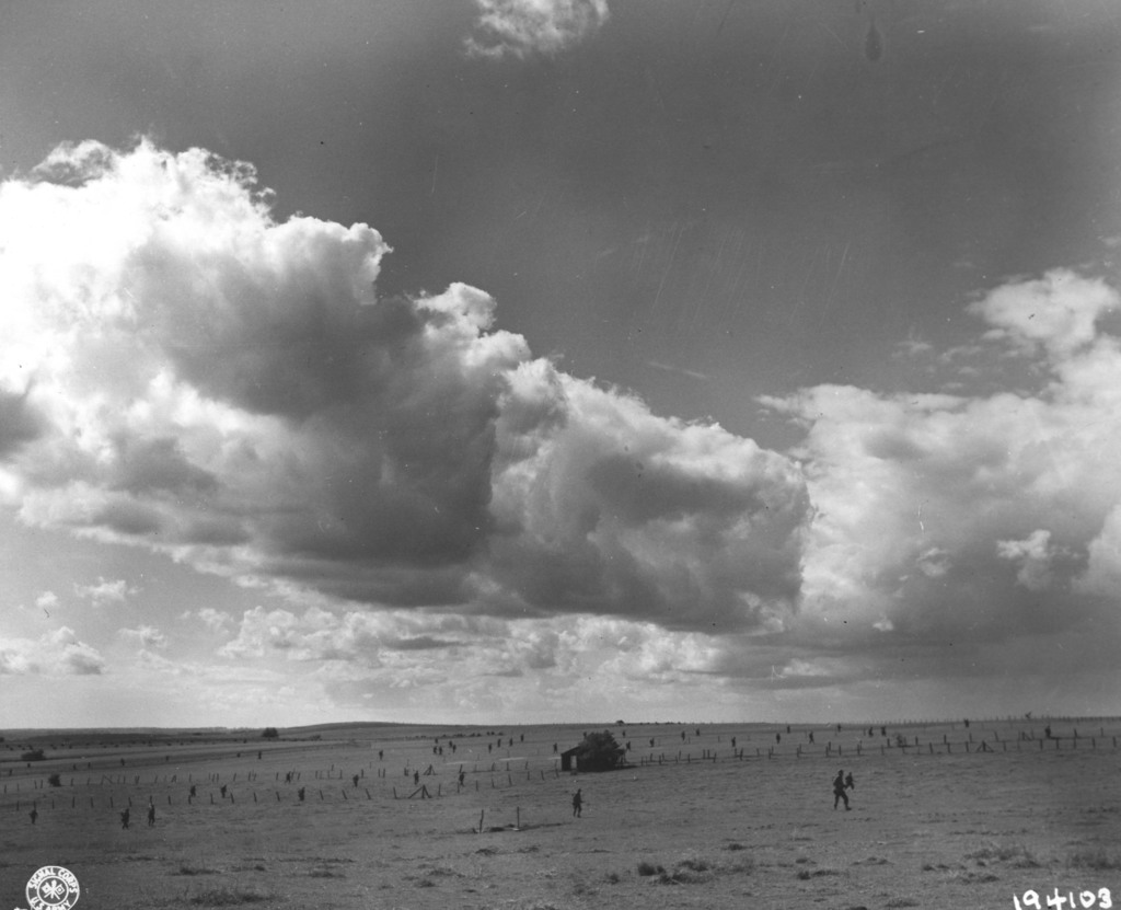 Photograph of Infantrymen Crossing a Belgian Farm near the Town of Habay-LA-Neuve