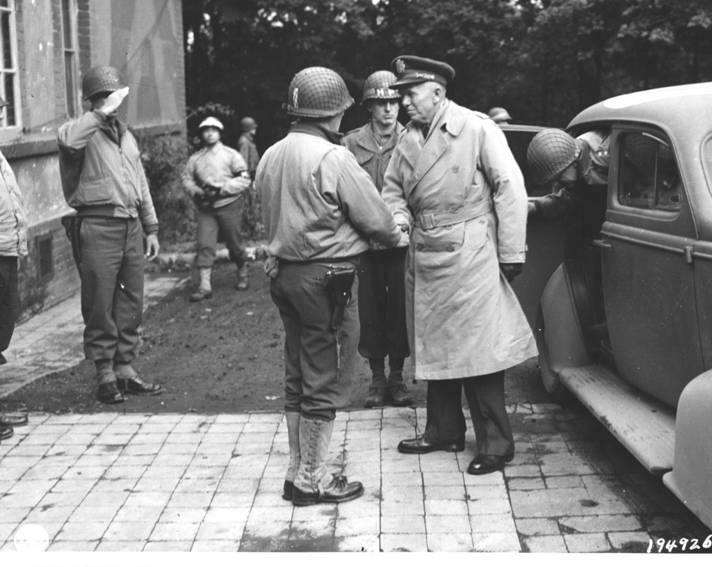 Photograph of Major General Norman Cota Greeting General George C. Marshall