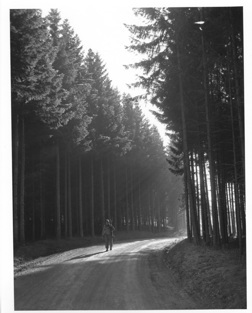 Photograph of Private First Class Margerum Walking through a Forest in Belgium