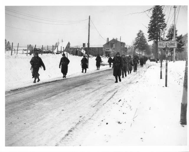 Photograph of Members of the 101st Airborne Division as they Move out of Bastogne, Belgium