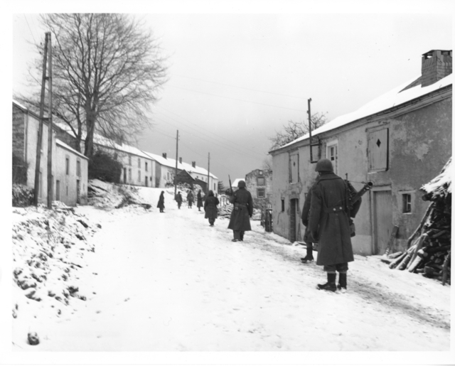 Photographs of Third Army Infantrymen Moving Cautiously through the Streets of Moircy, Belgium
