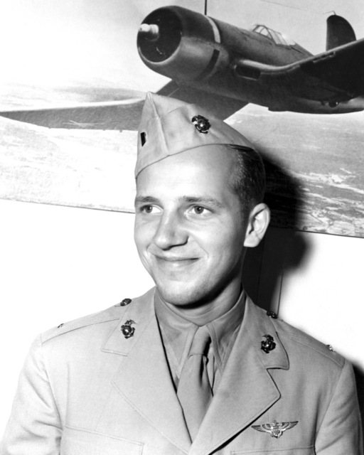 "Official Portrait of US Marine Corps (USMC) First Lieutenant (1LT) Charles W. Drake, taken at San Diego, California (CA), 1945. 1LT Drake is a World War II (WWII) Ace Pilot credited with 5 kills. A photograph of a US Navy F4U""CORSAIR""aircraft hangs in the background.  (Exact date shot unknown)"