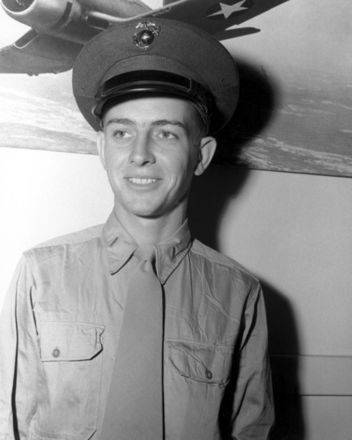 "Official Portrait of US Marine Corps (USMC) First Lieutenant (1LT) Dewey F. Durnford, taken at San Diego, California (CA), 1945. 1LT Durnford is a World War II (WWII) Ace Pilot credited with 6 kills also he awarded three Distinguished Flying Crosses and three Air Medals. A photograph of a US Navy F4U""CORSAIR""aircraft hangs in the background.  (Exact date shot unknown)"