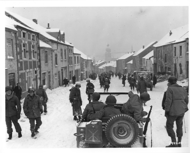 Photograph of American Infantrymen Entering the Town of St. Hubert, Belgium